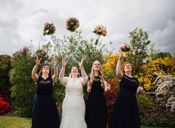 Bride throwing her bouquet at Cragwood Country House