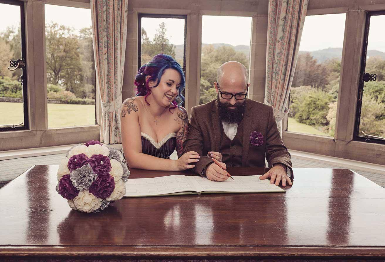 Signing the Wedding register at Cragwood